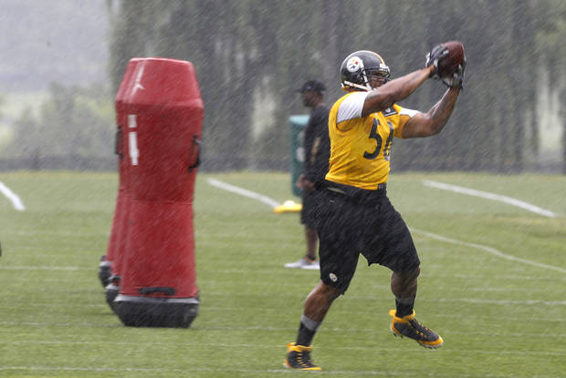 Pittsburgh Steelers outside linebacker LaMarr Woodley (56) catches a pass in a drill during a downpour at NFL football training camp in Latrobe, Pa., on Saturday, July 27, 2013. Practice was temporarily halted during a severe weather advisory. (AP Photo/Keith Srakocic)