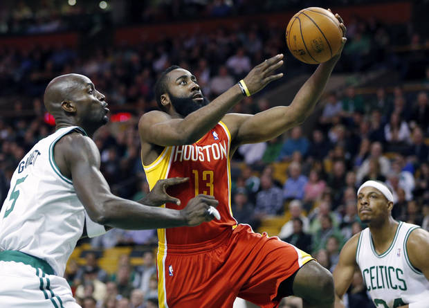 Houston Rockets' James Harden (13) goes up to shoot past Boston Celtics' Kevin Garnett (5) as Paul Pierce, right, watches during the first quarter of an NBA basketball game in Boston, Friday, Jan. 11, 2013. (AP Photo/Michael Dwyer) ORG XMIT: MAMD101
