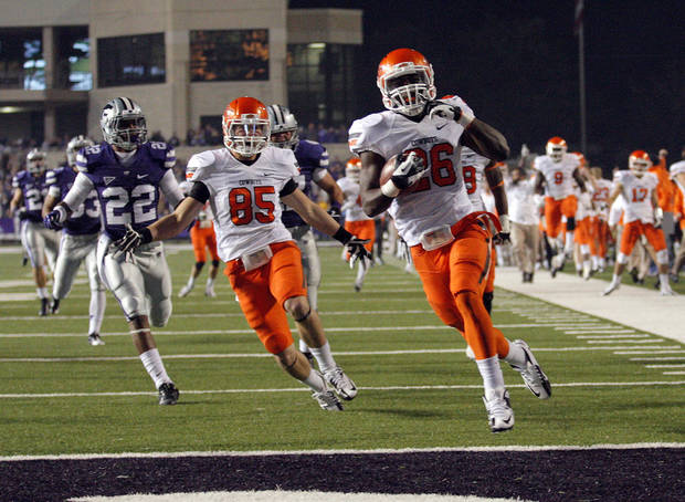 Oklahoma State&#039;s Desmond Roland (26) scores a touchdown on a kickoff return during the college football game between Kansas State University (KSU) and Oklahoma State (OSU) at  Bill Snyder Family Football Stadium in Manhattan, Kan.,  Saturday, Nov. 3, 2012. Photo by Sarah Phipps, The Oklahoman