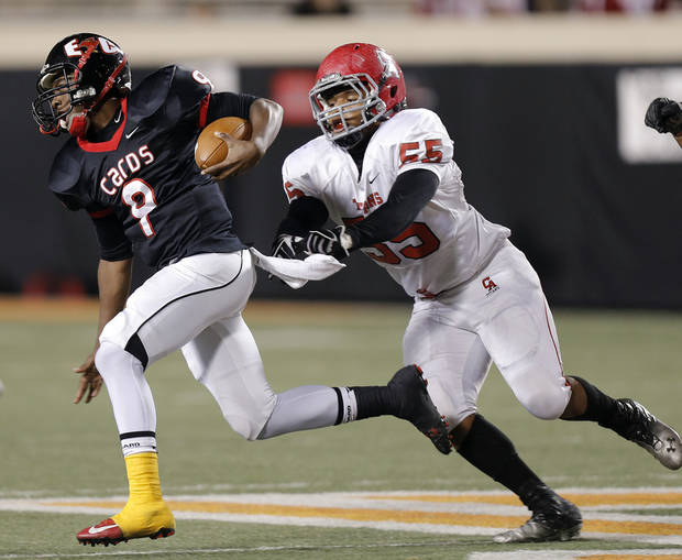 Carl Albert's Kyle Walker (55) tries to catch East Central's Trevaughn Cherry (9) during the Class 5A Oklahoma state championship football game between Carl Albert High School and Tulsa East Central High School at Boone Pickens Stadium on Saturday, Dec. 1, 2012, in Stillwater, Okla.   Photo by Chris Landsberger, The Oklahoman