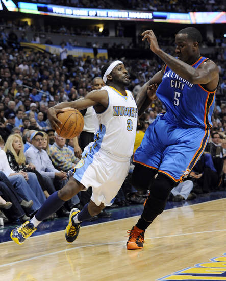 Denver Nuggets guard Ty Lawson (3) drives past Oklahoma City Thunder center Kendrick Perkins (5) during the second half in game 4 of a first-round NBA basketball playoff series Monday, April 25, 2011, in Denver. (AP Photo/Jack Dempsey)
