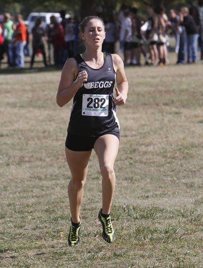Beggs' Regan Ward approaches the finish line to take third place during the girls class 3A State Cross Country meet at Gordon Cooper Vo-Tech in Shawnee, OK, Saturday, Oct. 22, 2011. Photo By Paul Hellstern, The Oklahoman Archives