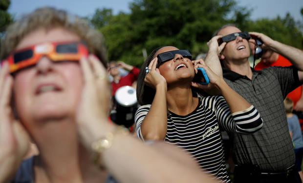 Erin Kozakiewicz, center, and Steve Whelchel use glasses while viewing the transit of Venus with the Oklahoma Astronomy Club's viewing at the Science Museum of Oklahoma on Tuesday, June, 5, 2012. Photo by Bryan Terry, The Oklahoman