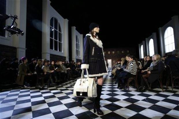 The Tommy Hilfiger Fall 2013 collection is modeled during Fashion Week in New York, Sunday, Feb. 10, 2013.  (AP Photo/Seth Wenig)