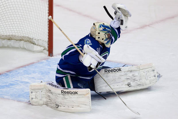 Vancouver Canucks' goalie Roberto Luongo makes a glove save against the Chicago Blackhawks during the second period of an NHL hockey game in Vancouver, British Columbia, on Friday, Feb. 1, 2013. (AP Photo/The Canadian Press, Darryl Dyck)