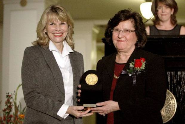 Kim Baker, left, presents Dr. Peggy Wisdom the Governor&#039;s Arts Award during the Oklahoma Arts Council 36th Annual Governor&#039;s Arts Awards at the state Capitol in Oklahoma City,  Tuesday, Nov. 15, 2011.  Photo by Sarah Phipps, The Oklahoman ORG XMIT: KOD
