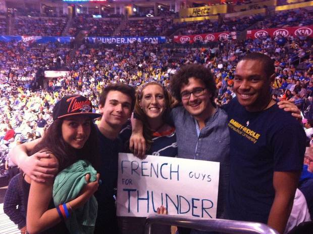 French students Carla Deroual Urbani, Jules Andreau and Louis David pose with Harding Charter Prep students, Angela Thompson-Butler and Alistair Connell at the April 15 Oklahoma City Thunder game at the Chesapeake Arena. PHOTO PROVIDED