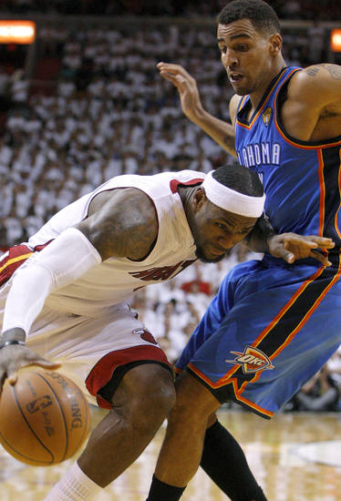Miami's LeBron James (6) drives past Oklahoma City's Thabo Sefolosha (2) during Game 3 of the NBA Finals between the Oklahoma City Thunder and the Miami Heat at American Airlines Arena, Sunday, June 17, 2012. Photo by Bryan Terry, The Oklahoman
