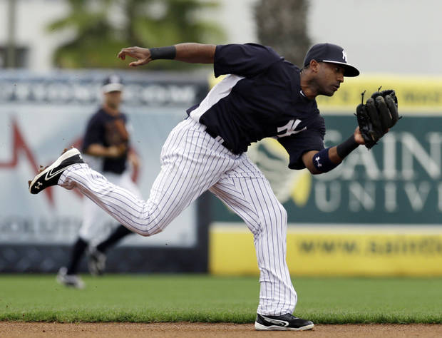 New York Yankees shortstop Eduardo Nunez fields a ball in the first inning of a spring training exhibition baseball game against the Boston Red Sox in Tampa, Fla., Wednesday, March 20, 2013. (AP Photo/Kathy Willens)