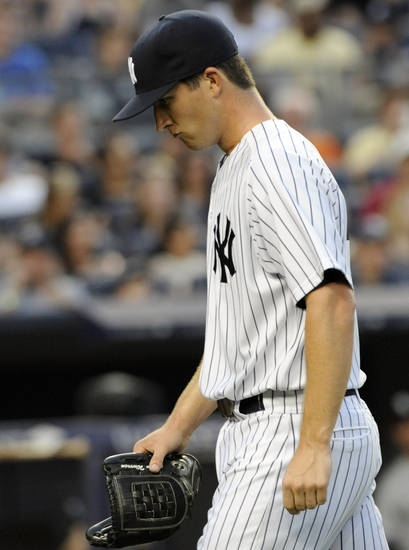 New York Yankees pitcher Adam Warren walks off the field after being removed from the baseball game during the third inning against the Chicago White Sox on Friday, June 29, 2012, at Yankee Stadium in New York. (AP Photo/Bill Kostroun)