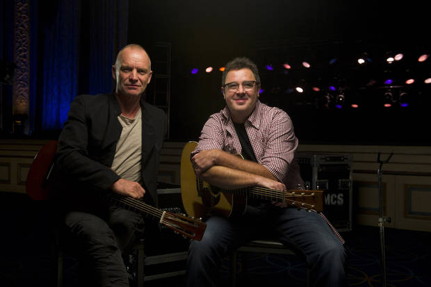 "FILE - In this Sept. 20, 2011 file photo, musicians Sting, left, and Vince Gill pose for a portrait at the Hammerstein Ballroom in New York. Sting and Vince will perform together on CMT�s ""Crossroads,"" airing Thursday, Nov. 24 at 8 pm EST.(AP Photo/Charles Sykes, file)"