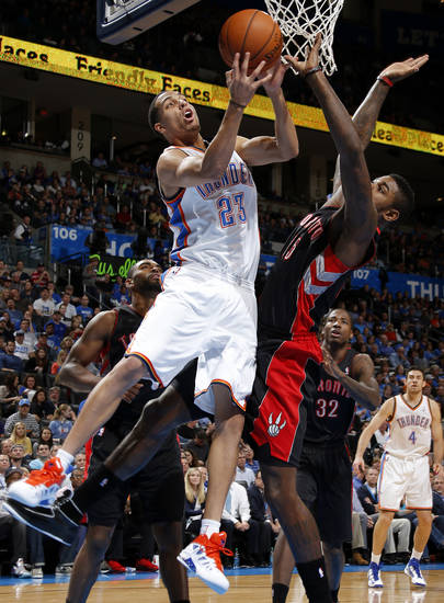 Oklahoma City's Kevin Martin (23) goes to the basket beside Toronto's Amir Johnson (15) during an NBA basketball game between the Oklahoma City Thunder and the Toronto Raptors at Chesapeake Energy Arena in Oklahoma City, Tuesday, Nov. 6, 2012.  Tuesday, Nov. 6, 2012. Photo by Bryan Terry, The Oklahoman