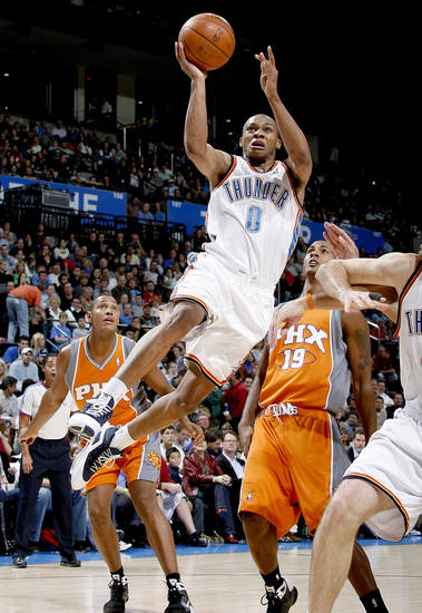 Oklahoma Ciy's Russell Westbrook drives to the basket between Boris Diaw, left, and Raja Bell during the NBA basketball game between the Oklahoma City Thunder and the Phoenix Suns at the Ford Center in Oklahoma City on Tuesday, Nov. 25, 2008.  BY BRYAN TERRY, THE OKLAHOMAN ORG XMIT: KOD