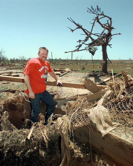 MAY 3, 1999 TORNADO: Tornado victims: Wesley Early stands in the ditch he took cover in as the tornado came over the hill behind him  in Bridge Creek. Goes with Watson story.