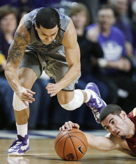Iowa State forward Georges Niang, right, knocks the ball away from Kansas State guard Angel Rodriguez during the second half of an NCAA college basketball game in Manhattan, Kan., Saturday, Feb. 9, 2013. Kansas State defeated Iowa State 79-70. (AP Photo/Orlin Wagner)