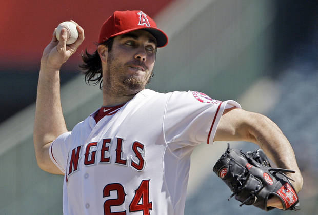 FILE - In this Sept. 27, 2012, file photo, Los Angeles Angels starter Dan Haren pitches to the Seattle Mariners in the second inning of a baseball game in Anaheim, Calif. A person familiar with the talks tells The Associated Press on Tuesday, Dec. 4, 2012, that the free agent pitcher and the Washington Nationals are close to completing a one-year deal for $13 million. (AP Photo/Reed Saxon, File)