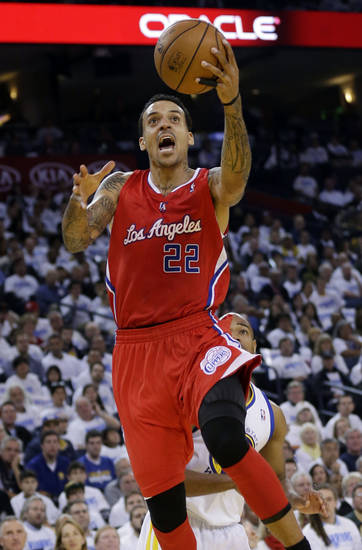 Los Angeles Clippers' Matt Barnes (22) goes up for a layup next to Golden State Warriors' Jarrett Jack during the first half of an NBA basketball game in Oakland, Calif., Wednesday, Jan. 2, 2013. (AP Photo/Marcio Jose Sanchez)