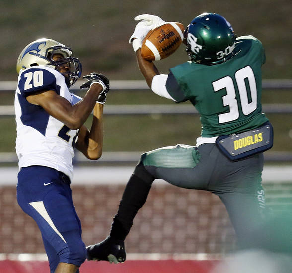 Edmond Santa Fe's Eric Davis (30) intercepts a pass intended for Southmoore's Aaron Holder (20) during a high school football game between Edmond Santa Fe and Southmoore at Wantland Stadium in Edmond, Okla., Thursday, Sept. 20, 2012. Photo by Nate Billings, The Oklahoman