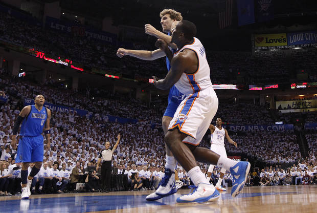 Oklahoma City's Kendrick Perkins (5) is pushed by Dallas' Dirk Nowitzki during Game 2 of the first round in the NBA basketball playoffs between the Oklahoma City Thunder and the Dallas Mavericks at Chesapeake Energy Arena in Oklahoma City, Monday, April 30, 2012. Photo by Sarah Phipps, The Oklahoman