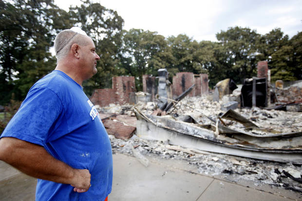 George Reich looks at his home destroyed by wildfire on Blackjack Lane in Edmond, Okla.,  Sunday, Aug. 7, 2011. Photo by Sarah Phipps, The Oklahoman
