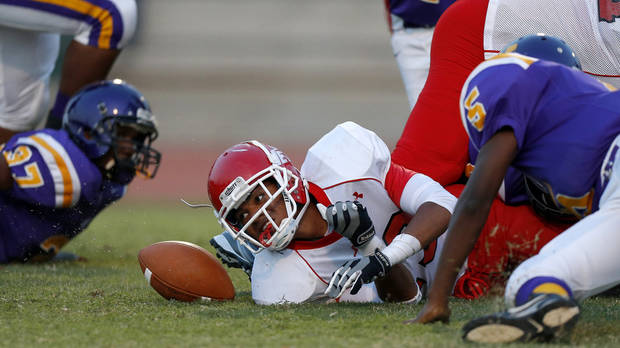 Western Heights&#039; Xavier McLaurin fumbles the ball  during a high school football game against Northwest Classen at Taft Stadium in Oklahoma City, Thursday, September 20, 2012. Photo by Bryan Terry, The Oklahoman