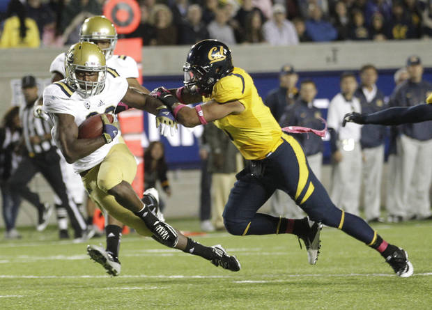 UCLA running back Johnathan Franklin (23) runs for a first down past California defensive back Michael Lowe (5) during the second half of an NCAA college football game in Berkeley, Calif., Saturday, Oct. 6, 2012. California won 43-17. (AP Photo/Tony Avelar)