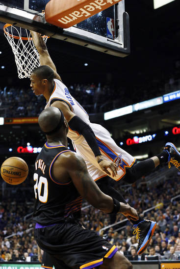 Oklahoma City Thunder's Russell Westbrook, right, dunks over Phoenix Suns' Jermaine O'Neal (20) during the first half in an NBA basketball game, Sunday, Feb. 10, 2013, in Phoenix. (AP Photo/Ross D. Franklin)