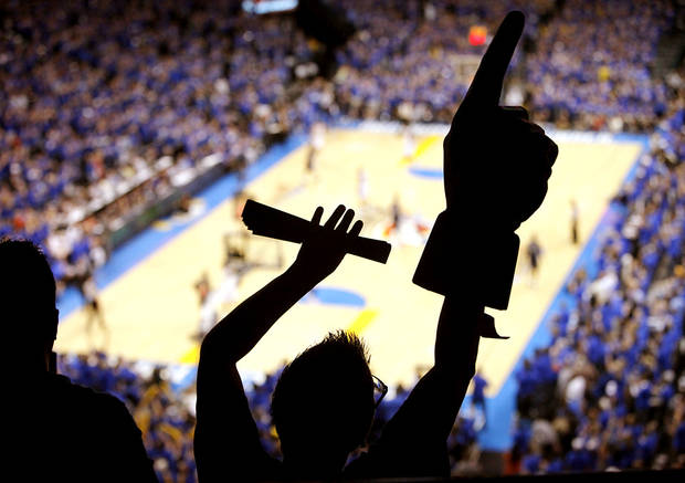 Wearing a foam finger and cheering from Loud City, Sabrina Darville of Oklahoma City celebrates a Thunder basket during the second half of Game 7 of the NBA basketball Western Conference semifinals between the Memphis Grizzlies and the Oklahoma City Thunder at Chesapeake Energy Arena on Sunday, May 15, 2011. Photo by John Clanton/The Oklahoman