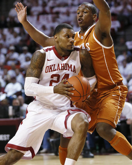 Oklahoma's Romero Osby (24) drives to the basket against Texas' Jonathan Holmes (10) during an NCAA college basketball game in Norman, Okla., Monday, Jan. 21, 2013. (AP Photo/The Oklahoman, Nate Billings)