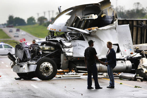 This tractor-trailer was crumpled after it was lifted from the interstate and dropped on US 177 about 20 feet below. A tornado caused extensive damage along I-40 at the junction with  US 177 on the west side of Shawnee Sunday evening,  May 19,  2013.  Photo  by Jim Beckel, The Oklahoman.