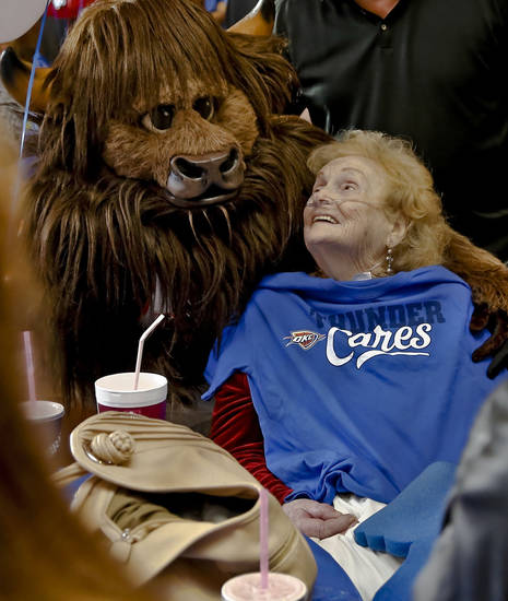 Right: Rumble poses with Helen LaRue during the holiday party Tuesday in Yukon. Photos by Chris Landsberger, The Oklahoman