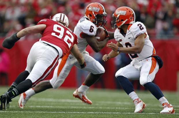 Wisconsin defensive lineman Pat Muldoon (92) chases down Illinois running back Josh Ferguson (6) as Illinois' Nathan Scheelhaase (2) defends during the first half of an NCAA college football game on Saturday, Oct. 6, 2012, in Madison, Wis. (AP Photo/Andy Manis)