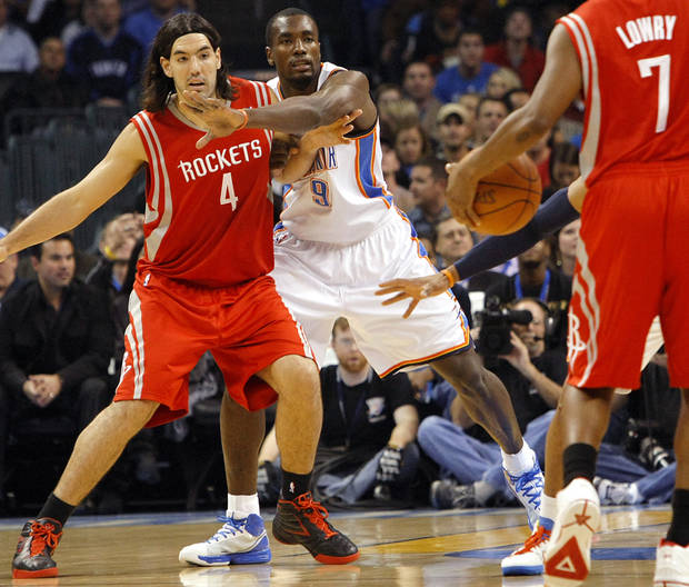 Oklahoma City's Serge Ibaka guards Houston's Luis Scola during their NBA basketball game at the OKC Arena in downtown Oklahoma City on Wednesday, Nov. 17, 2010. Photo by John Clanton, The Oklahoman