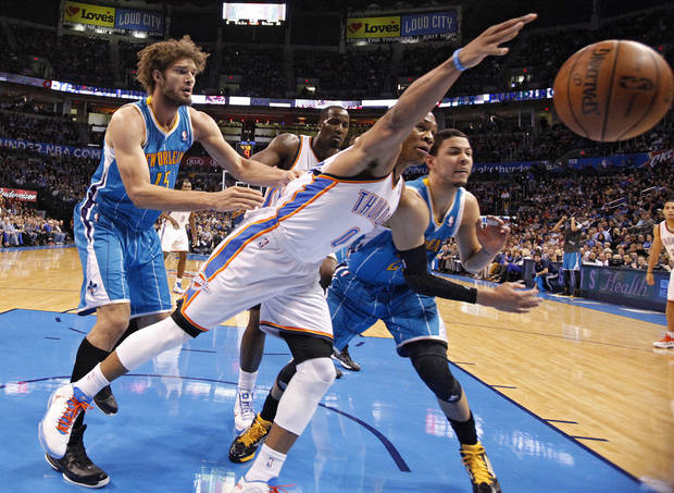 Oklahoma City Thunder's Russell Westbrook (0) fights for a loose ball with New Orleans Hornets' Austin Rivers (25) and Robin Lopez (15) during the NBA basketball game between the Oklahoma CIty Thunder and the New Orleans Hornets at the Chesapeake Energy Arena on Wednesday, Dec. 12, 2012, in Oklahoma City, Okla.   Photo by Chris Landsberger, The Oklahoman