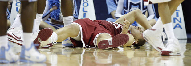 OU's Blake Griffin lays on the court after loosing the ball out of bounds during second-half action against North Carolina on Sunday. PHOTO BY CHRIS LANDSBERGER, THE OKLAHOMAN