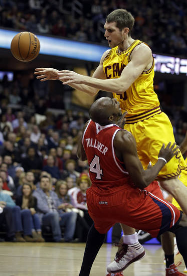 Cleveland Cavaliers' Tyler Zeller charges into Atlanta Hawks' Anthony Tolliver (4) in the second quarter of an NBA basketball game, Friday, Dec. 28, 2012, in Cleveland. (AP Photo/Mark Duncan)
