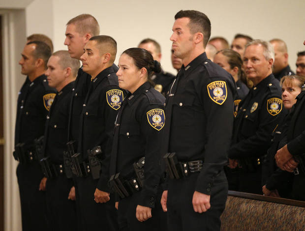 Graduating cadets stand during a commencement ceremony for the 50th Norman Police Department Training Academy. PHOTO BY BRYAN TERRY, THE OKLAHOMAN <strong>Bryan Terry</strong>