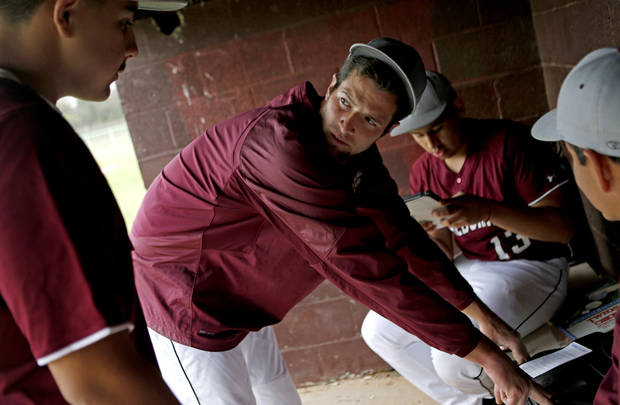 HIGH SCHOOL BASEBALL: Capitol Hill baseball coach Mike Hinckley talks with his team before a game in Oklahoma City, Tuesday, April 16, 2013. Photo by Bryan Terry, The Oklahoman