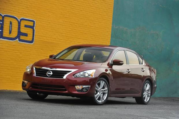 This undated photo provided by Nissan shows the 2013 Nissan Altima Sedan. This fifth-generation Altima, with a federal government�s rating of 27 miles per gallon in city driving and 38 mpg on the highway, is slightly larger and has more power than its predecessor and is restyled inside and out for a more upscale appearance. (AP Photo/Nissan)
