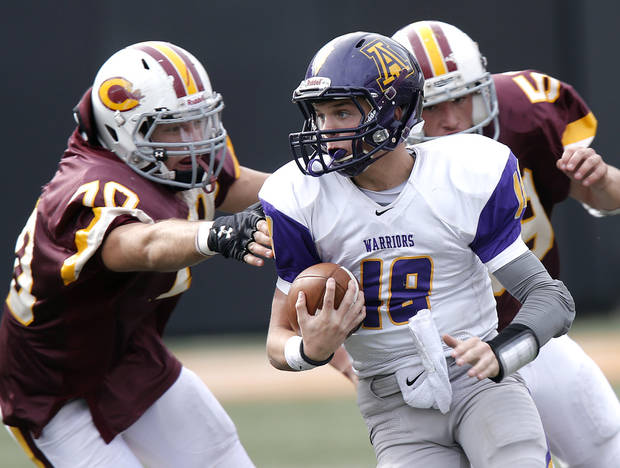 Anadarko&#039;s Brandon Pollard (18) runs past Clinton&#039;s Owen Poe (70) during the Class 4A Oklahoma state championship football game between Anadarko and Clinton at Boone Pickens Stadium on Saturday, Dec. 1, 2012, in Stillwater, Okla.   Photo by Chris Landsberger, The Oklahoman