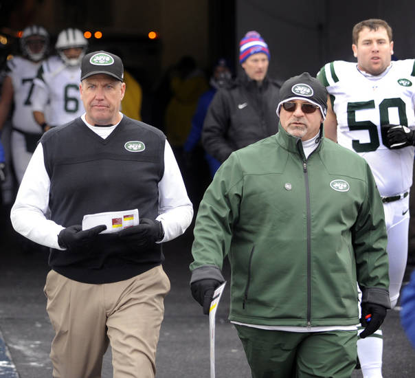 FILE - This Dec. 30, 2012 file photo shows New York Jets head coach Rex Ryan, left, walking with offensive coordinator Tony Sparano after halftime of an NFL football game against the Buffalo Bills in Orchard Park, N.Y. Sparano has been fired as the Jets' offensive coordinator, Tuesday, Jan. 8, 2013,  after one season in which the offense ranked among the league's worst.(AP Photo/Gary Wiepert, File)