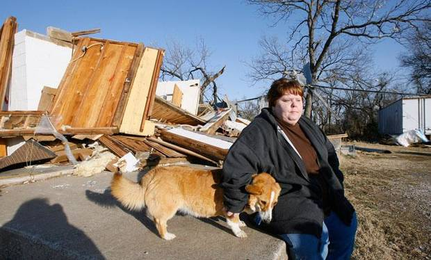 Trina Quinton sits with a lost dog at her cousin's destroyed furniture store, John's Furniture, on the north side of SH 70 in Lone Grove Wednesday, Feb. 11, 2009. BY PAUL B. SOUTHERLAND, THE OKLAHOMAN