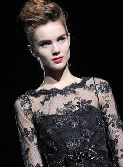 The Badgley Mischka Fall 2013 collection is modeled during Fashion Week, Tuesday, Feb. 12, 2013, in New York. (AP Photo/Louis Lanzano)