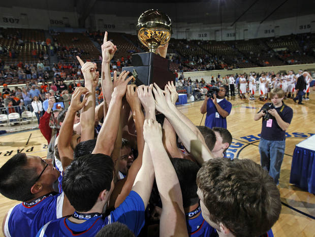 The Fort Cobb-Broxton Mustangs celebrate with the gold ball trophy after the Class A boys basketball state tournament championship game between Cheyenne-Reydon and Fort Cobb-Broxton at State Fair Arena in Oklahoma City, Saturday, March 5, 2011. Fort Cobb-Broxton won, 50-41. Photo by Nate Billings, The Oklahoman