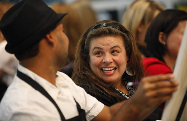 Aravind Seshadri, left, laughs with Brenda Morales during a class at Wine & Palette in Oklahoma City, Tuesday, Dec. 11, 2012. Photo by Bryan Terry, The Oklahoman