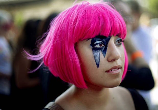 Sheyda Zakerion of Tulsa waits outside the Ford Center for the Lady Gaga concert in Oklahoma City on Tuesday, July 20, 2010.  Photo by Bryan Terry, The Oklahoman