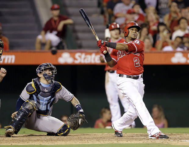Los Angeles Angels' Erick Aybar and Tampa Bay Rays catcher Jose Lobaton watch Aybar's home run in the fourth inning of a baseball game in Anaheim, Calif., Monday, Sept. 2, 2013. (AP Photo/Reed Saxon)