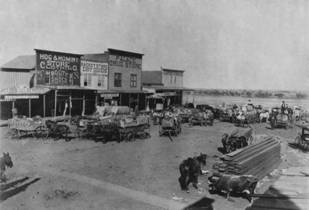"EARLY DAYS / PURCELL / STREET SCENES:   ""Early Day--Purcell, Oklahoma 50 years ago.""  Copy work done by staff photographer, Alphia Hart on 4/28/1939."