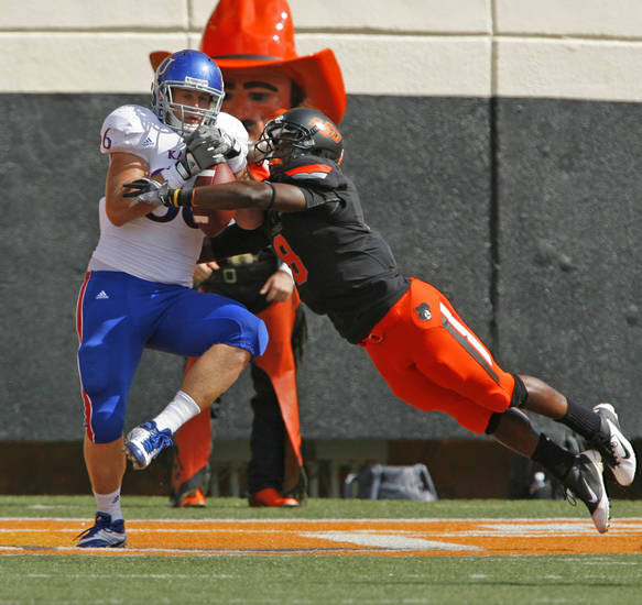 Kansas' Tim Biere (86) catches a pass in he end zone covered by Oklahoma State's Daytawion Lowe (8) during a college football game between the Oklahoma State University Cowboys (OSU) and the University of Kansas Jayhawks (KU) at Boone Pickens Stadium in Stillwater, Okla., Saturday, Oct. 8, 2011 Photo by Steve Sisney, The Oklahoman