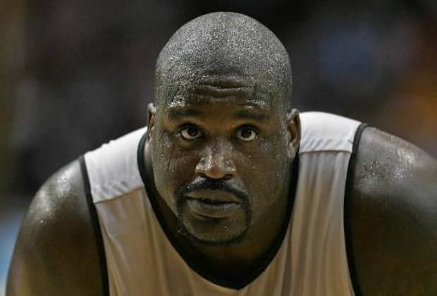 Cleveland Cavaliers  Shaquille  O'Neal looks on during the Wine and Gold basketball scrimmage at James A. Rhodes Arena on Saturday, Oct. 3, 2009, in Akron, Ohio.(AP Photo/Akron Beacon Journal, Phil Masturzo)